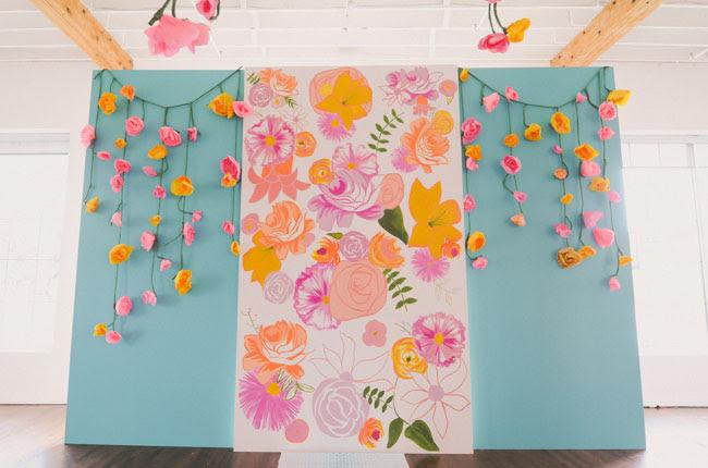 draped paper flower ceremony backdrop