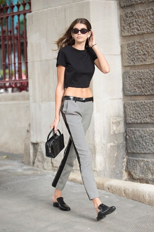 Le Fashion Blog Kaia Gerber Model Off Duty Cropped Black Top Houndstooth Trousers Black Mini Bag Black Mules Via Vogue