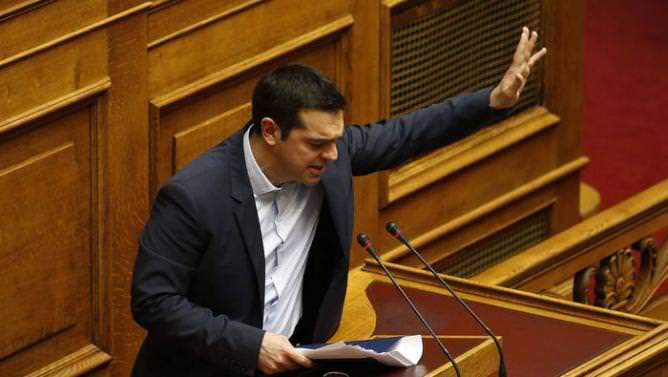 Greek Prime Minister Tsipras waves to lawmakers following his first major speech in parliament in Athens