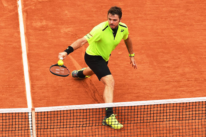 Switzerland's Stan Wawrinka hits a backhand during his quarter-final match against Spain's Alberto Ramos Vinolas