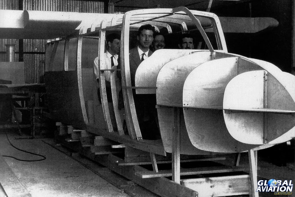 The BN-2 wooden mock up being tried out for size  - occupants (left to right) are Ernie Perkins, Desmond Norman, John Britten and Denis Berryman