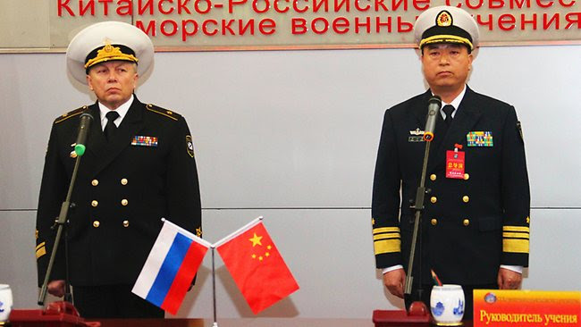 http://resources3.news.com.au/images/2012/04/22/1226335/751827-120422-china-russia-navy-drills.jpg