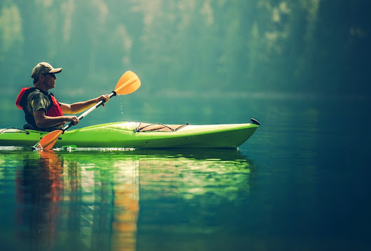 Go Kayaking Near Lake Delton Homes with Vertical Illusion Tours