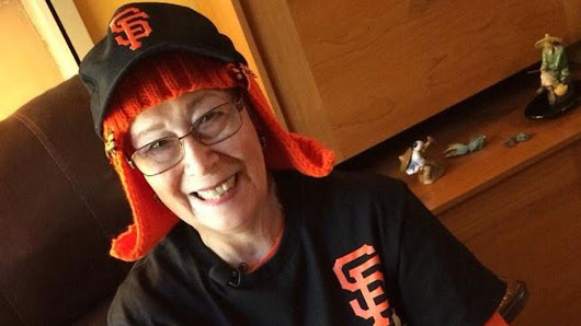 San Jose grandma going through chemo knits herself new hair in bright San Francisco Giants orange