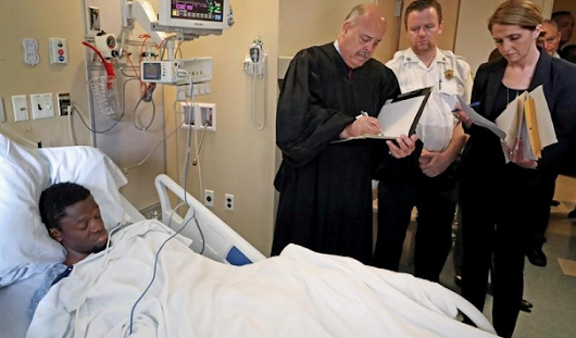 Boston Murders Suspect Arraigned From Hospital Bed - World Justice News