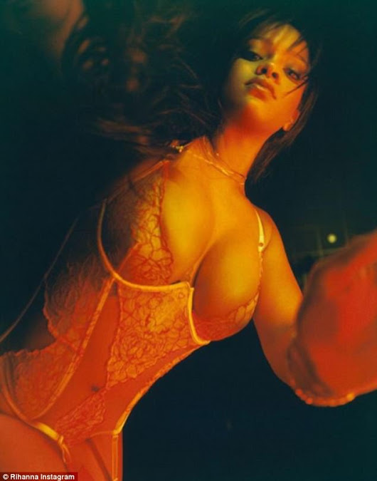 Rihanna turns up the heat as she flashes glimpse of her lacy underwear while striking a sultry pose for new lingerie line
