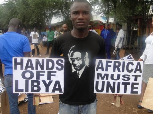 Ghanaians demonstrate against the US-NATO invasion and occupation of the North African state of Libya. These demonstratios coincide with the 102nd anniversary of the birth of Kwame Nkrumah. by Pan-African News Wire File Photos