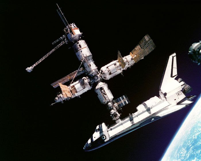 Space shuttle ATLANTIS is docked to the Russian space station MIR in 1995.