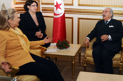 "U.S. Secretary of State Hillary Clinton meeting with Tunisian Interim President Fouad Mebazaa at the presidential palace in the capital city of Tunis. The U.S. pledged to assist in the ""democratic transition."" by Pan-African News Wire File Photos"