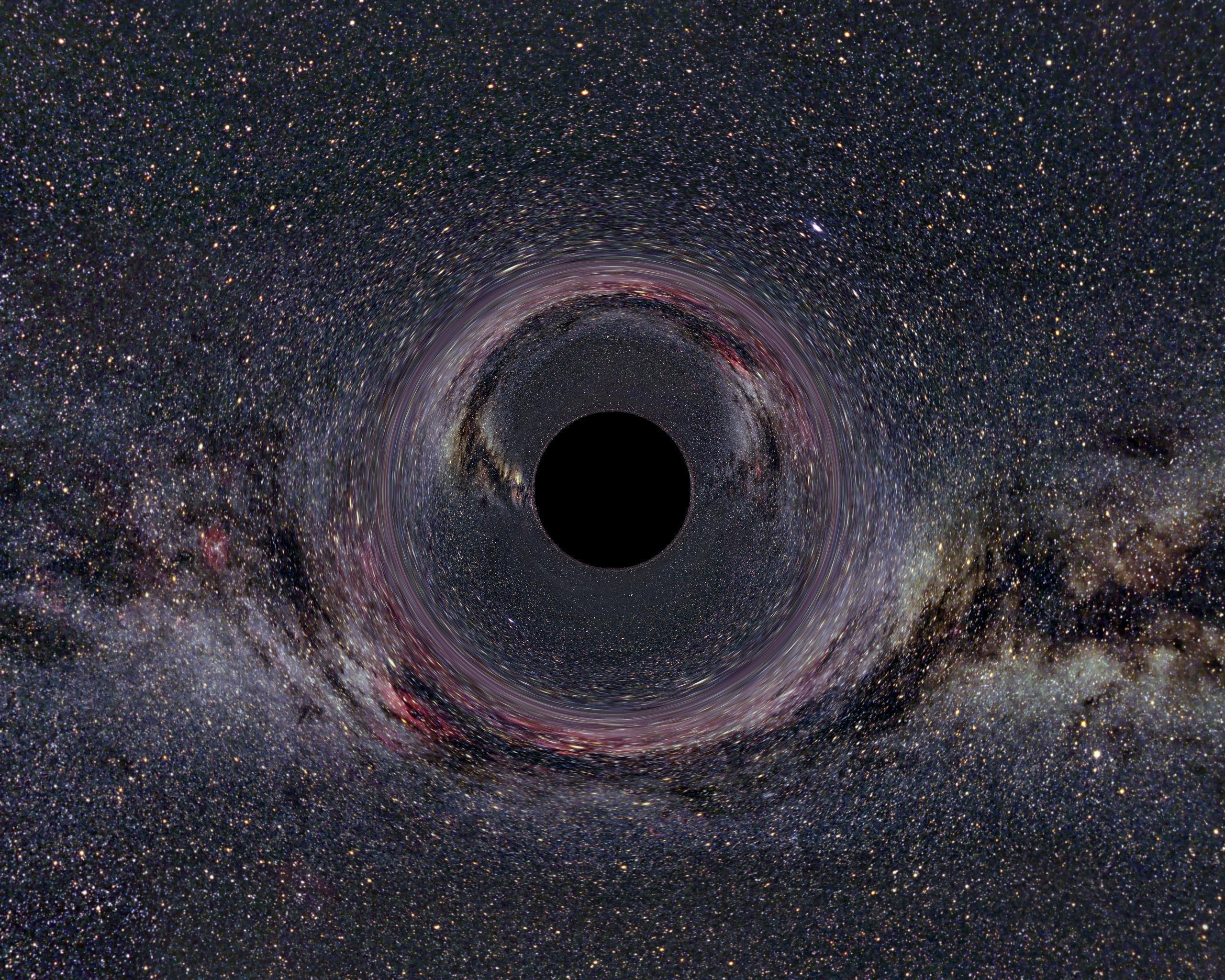 Cientistas simulam colisão entre um buraco negro grande e um pequeno