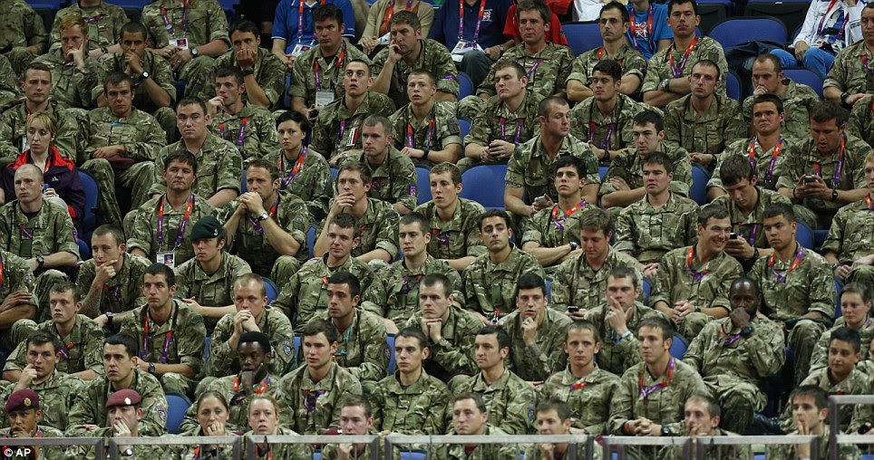 Watching on: This group of soldiers were invited to watch the Gymnastics events
