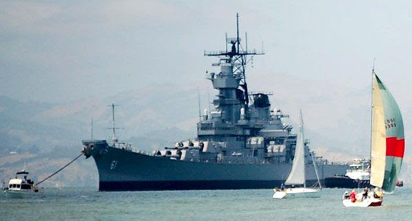 The USS Iowa is surrounded by sailboats and other vessels as the battleship embarks on a final trip to SoCal, on May 26, 2012.