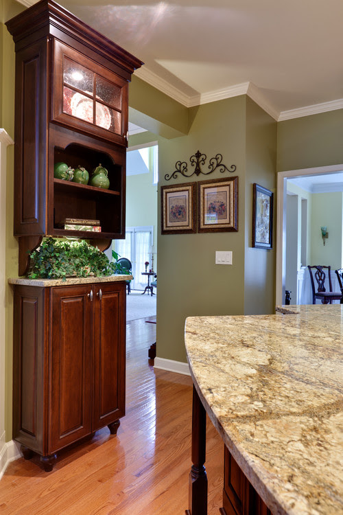love the green paint with the cherry cabinets. will you ...