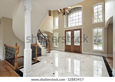 Foyer And Circular Staircase In New Construction Home Stock Photo ...