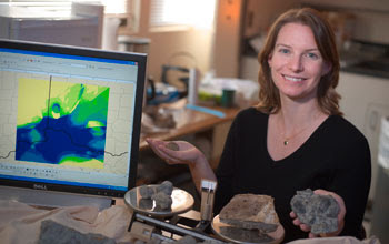 Photo of scientist Alycia Stigall on the right and a computer monitor on the left.