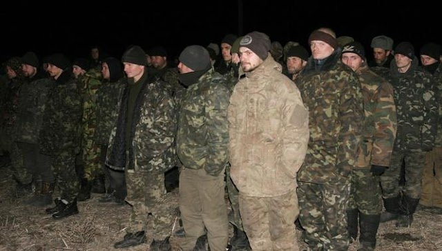 Late Update: Ukraine, pro-Russia rebels swap dozens of prisoners