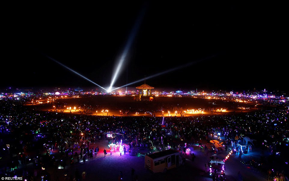 Lights shining across the temporary city as thousands of participants gather to watch the Man burn