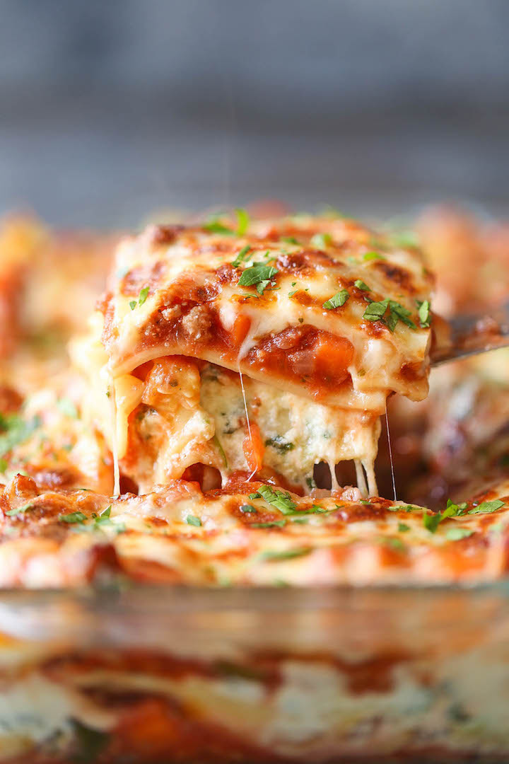 Turkey and Spinach Veggie Lasagna - Lightened-up, skinny lasagna with ground turkey and plenty of vegetables - carrots, onion, zucchini and spinach!