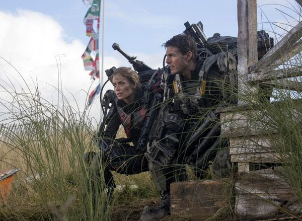 Cage (Tom Cruise) and Rita (Emily Blunt) must fight their way through Europe and defeat the alien threat posed by the Mimics in EDGE OF TOMORROW.