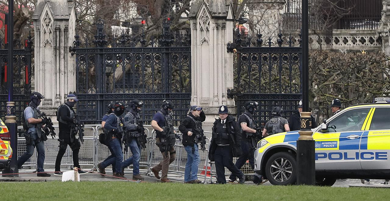 Armed police officers enter the Houses of Parliament in London, Wednesday, March 23, 2017 after the House of Commons sitting was suspended as witnesses reported sounds like gunfire outside.