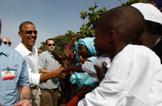 U.S. President Barack Obama greets well-wishers during his visit to Goree Island near Dakar
