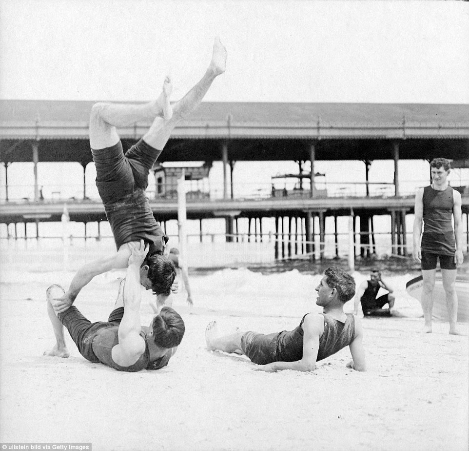 Acrobatics: New York young men play on the beach in 1904 while there is space on the sand before the crowds descend