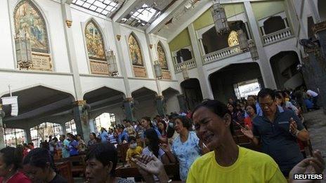 A devotee cries during Sunday Mass at Santo Nino Church in Tacloban. Photo: 17 November 2013