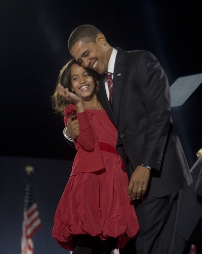Happy Barack and Malia Obama hugging on election night before victory speech