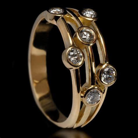 18ct Gold Multi strand Diamond Ring   Williamson Brown