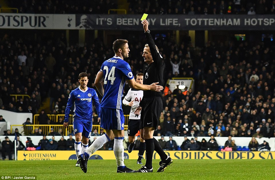 Chelsea's experienced defender Gary Cahill becomes the second away player to get booked after pulling back Eriksen