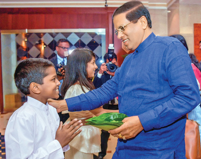 President Maithripala Sirisena arrived in London last morning (April 16) to attend the Commonwealth Heads of Government Meeting (CHOGM) 2018. He was received by the Commonwealth officials and Sri Lanka High Commission staff. Here, a Sri Lakan child offering betel leaves to receive the President in keeping with the traditional customs. Picture by Sudath Silva