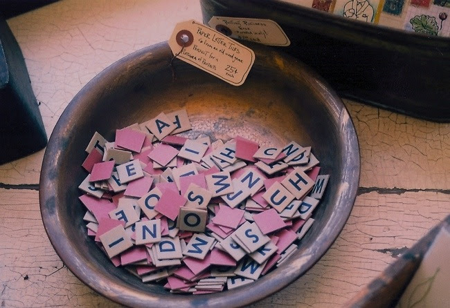 paper letter tiles in a beautiful copper bowl.
