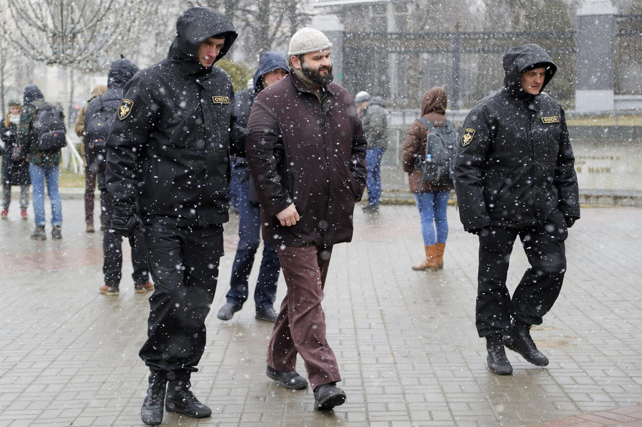 Belarus police detain a man prior to an opposition rally in Minsk, Belarus, Saturday, March 25, 2017. Over the past two months, protests have broken out across the country of 9.5 million, sometimes attracting thousands — initially they were focused on the labor law but have grown to encompass calls for the resignation of President Alexander Lukashenko, whom critics call Europe's last dictator.