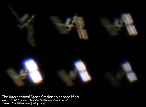 Above: Sunlight glints from the space station's solar arrays on May 22, 2009. Photo credit: Quintus Oostendorp of Vaassen, the Netherlands.