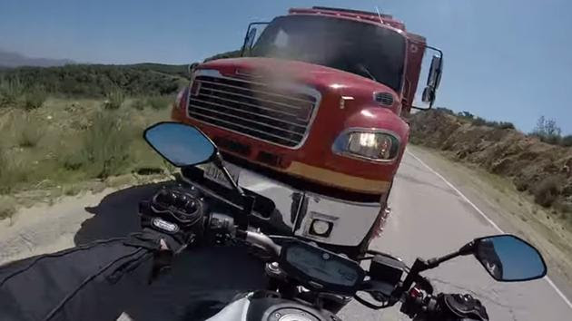 Dramatic GoPro video captures motorcycle crash with firetruck