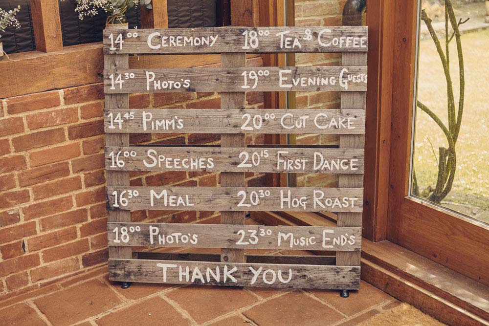 rustic wooden pallet wedding time table - www.helloromance.co.uk
