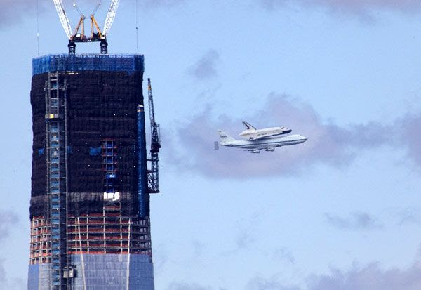The shuttle Enterprise and NASA 905 fly near the 1 World Trade Center in New York City on April 27, 2012.