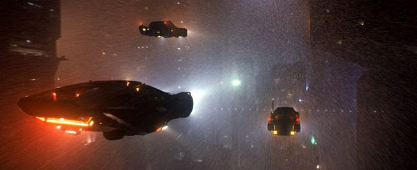 Futuristic cars fly through the city of Los Angeles in BLADE RUNNER 2049.