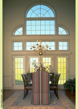 A sublime Palladian window frames this dining room