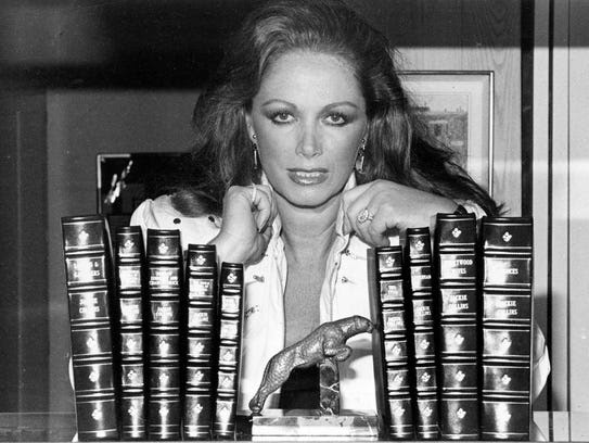 In this July 19, 1984 file photo, Jackie Collins poses