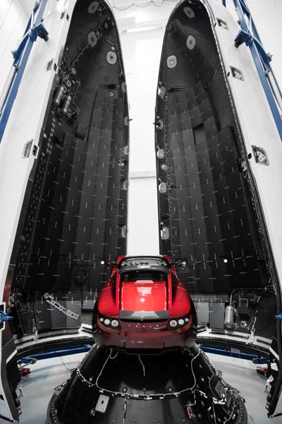 The Tesla Roadster that the Falcon Heavy will send towards Mars on its maiden flight is about to be enshrouded by the rocket's two huge payload fairings.