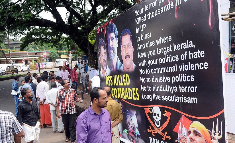 A poster at CPM rally in Kannur blames BJP-RSS for violence in Kerala. SK Mohan/Firstpost