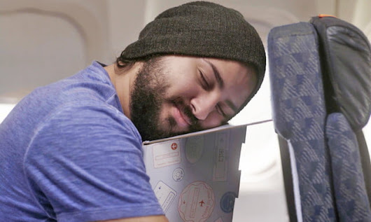 This piece of cardboard may help you sleep soundly on long flights