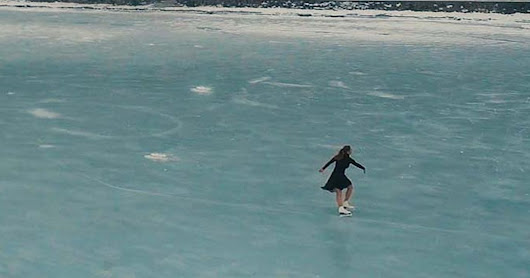 Figure skater glides across the biggest lake in Europe in a breathtaking routine on frozen water