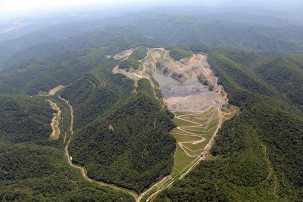 An aerial photograph taken in southern West Virginia in May shows one effect of mountaintop-removal mining: a slurry pond at a mining site.