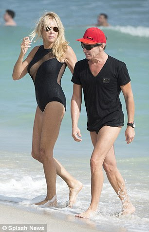 At one point he went for a swim in his speedo, but kept his T-shirt and cap on