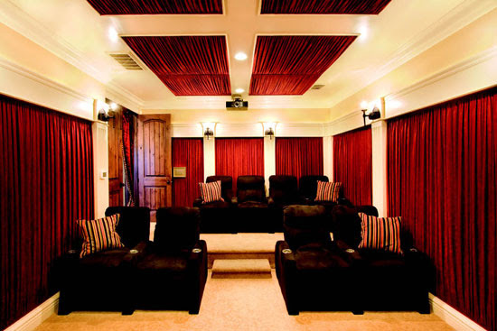 Dramatic Home Theater Design With Curtains on Every Wall | DigsDigs