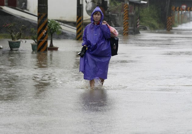 Woman walks in floods caused by Typhoon Nanmadol in Chiangyuan, Pingtung County, southern Taiwan