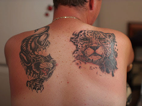 Big Alan's panther & leopard tattooed over four sessions by Bob Baines of