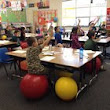 Sherwood's Hopkins Elementary School's second grade class swaps chairs for fitness balls